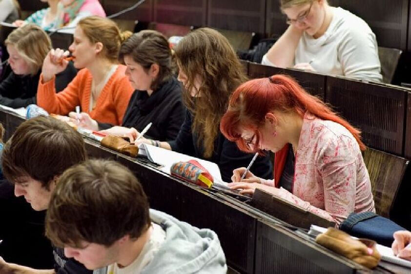 Students writing in a lecture hall